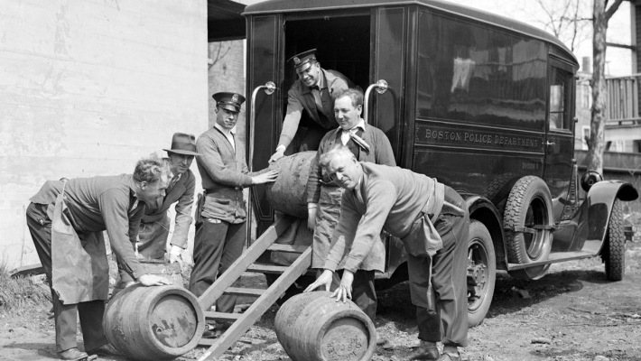 men loading booze into the back of a truck
