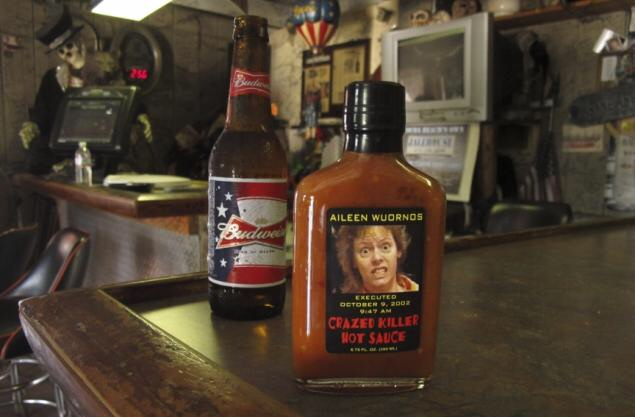 Photo of bbq sauce with Wournos face on label at Last Resort Bar